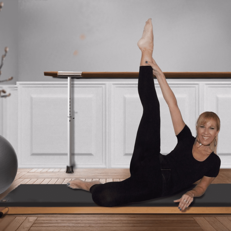 Lady practices Pilates on the mat