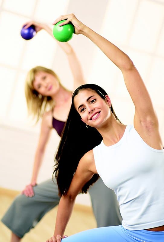 Image of two women in a Stott Pilates training